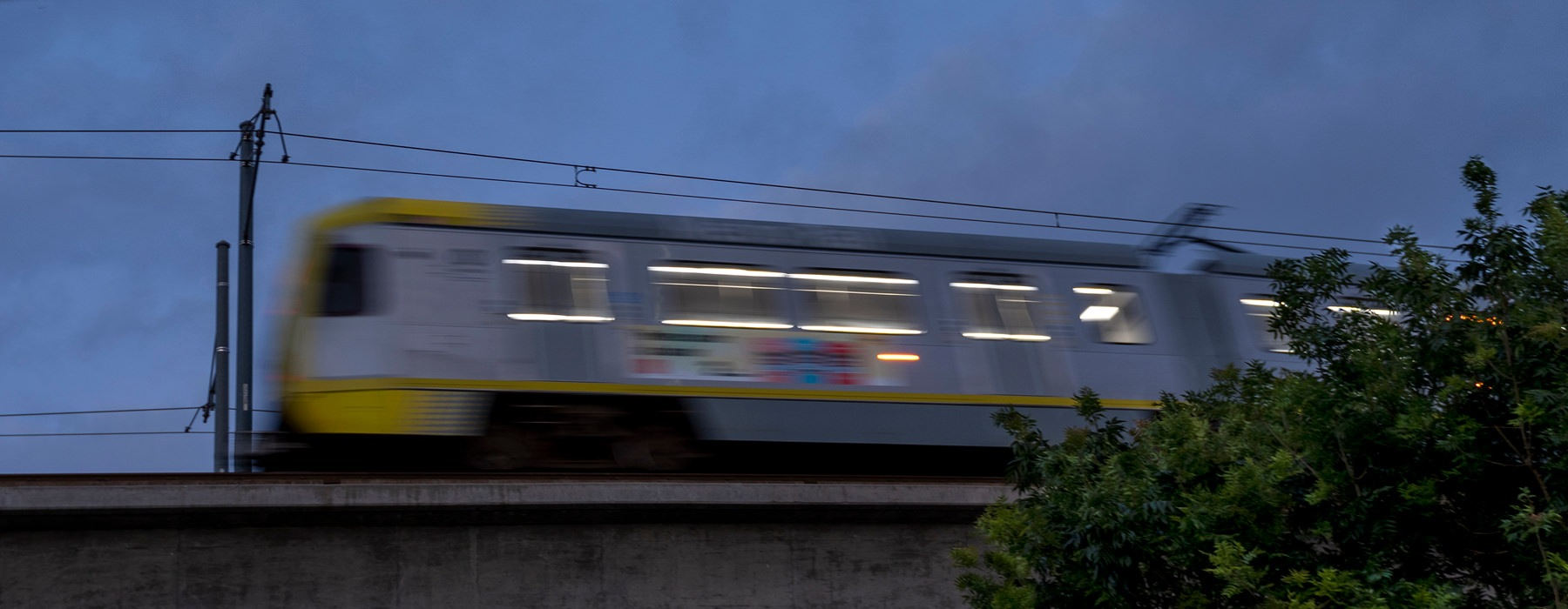 train passing on overhead tracks